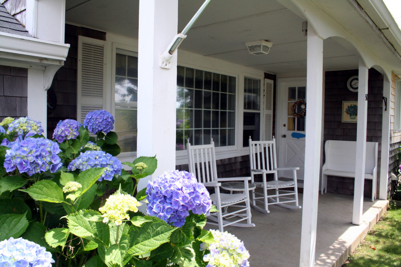 Street side porch complements the oceanside deck.